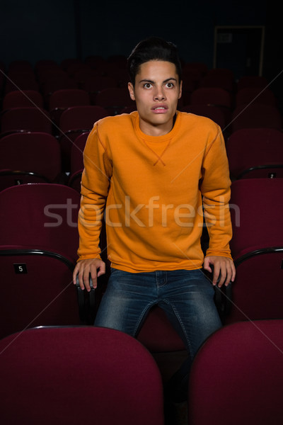 Man with shocked expression looking at the movie in theatre Stock photo © wavebreak_media