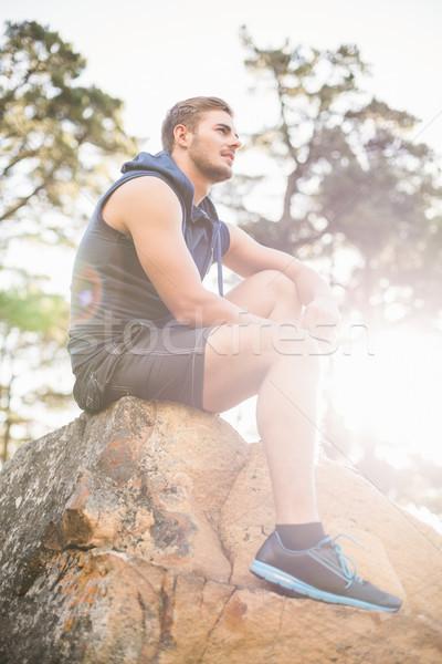 Fiatal boldog kocogó ül kő másfelé néz Stock fotó © wavebreak_media