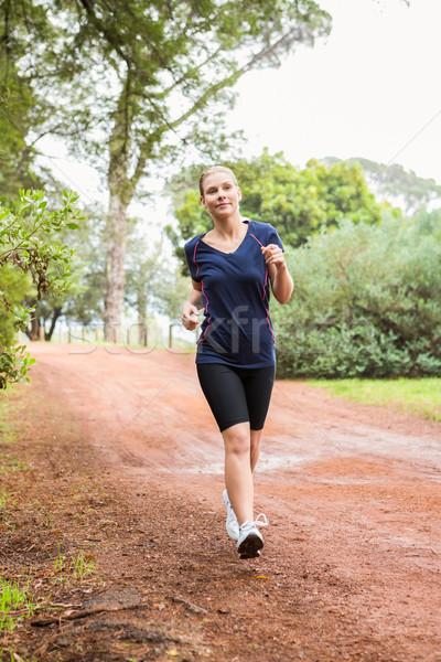 Athletic woman running on a footpath Stock photo © wavebreak_media