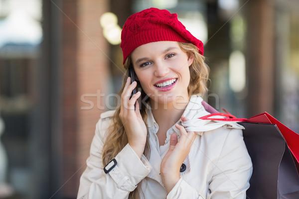 Gülümseyen kadın telefon alışveriş merkezi kadın mutlu moda Stok fotoğraf © wavebreak_media