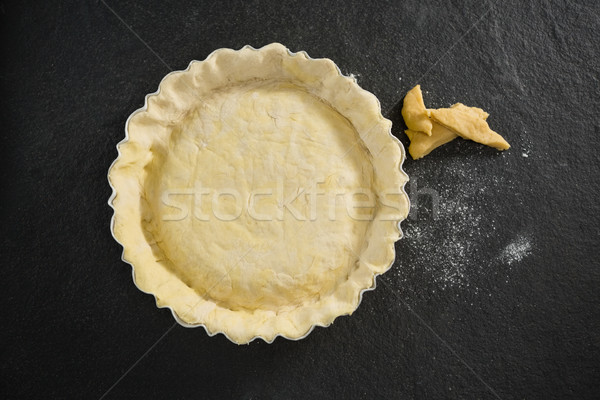 Overhead view of pastry dough in backing pan Stock photo © wavebreak_media