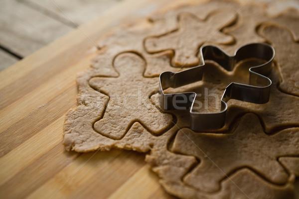 Gingerbread man moul on dough Stock photo © wavebreak_media