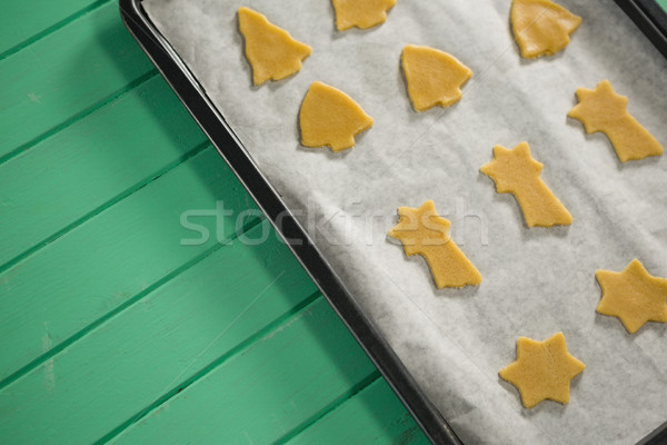 High angle view of various shape raw cookies in baking sheet Stock photo © wavebreak_media