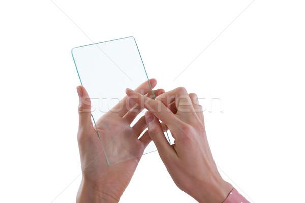 Woman using glass mobile phone Stock photo © wavebreak_media