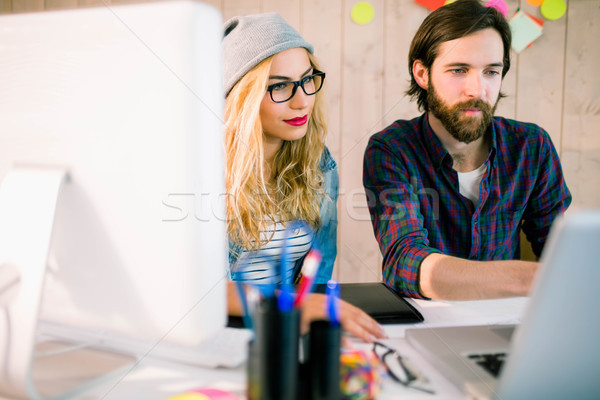 Stock photo: Creative team working at desk with laptop