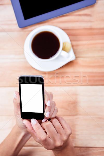 Vrouwelijk handen smartphone tablet koffie biscuit Stockfoto © wavebreak_media