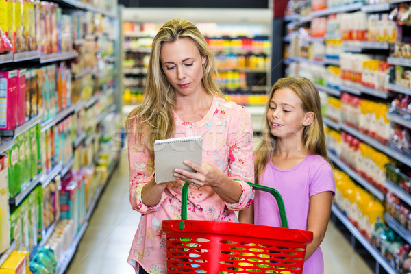 Mother and daughter checking list Stock photo © wavebreak_media