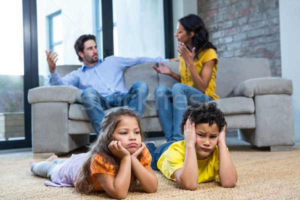 Children laying on the carpet in living room Stock photo © wavebreak_media