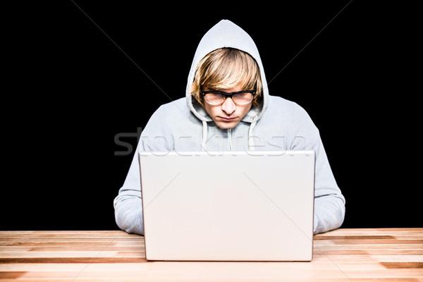 Uomo giacca l'hacking laptop nero tecnologia Foto d'archivio © wavebreak_media