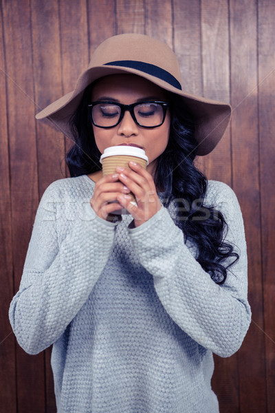 Asian woman drinking by disposable cup Stock photo © wavebreak_media