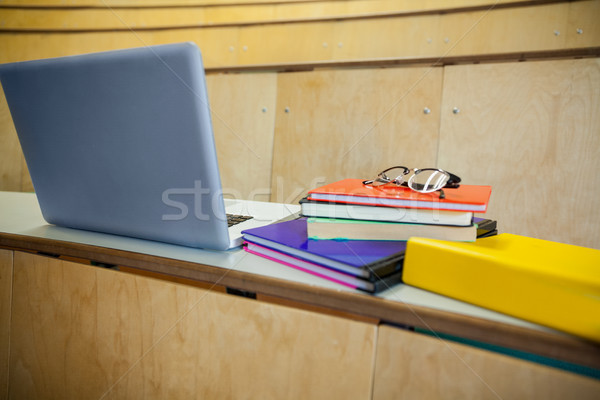 Students books and laptop in an auditorium Stock photo © wavebreak_media