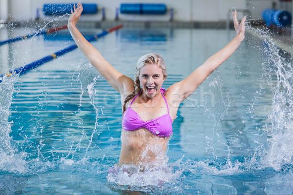 Stock photo: Pretty woman doing aqua aerobics