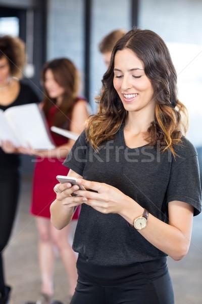 Businesswoman text messaging on smartphone Stock photo © wavebreak_media