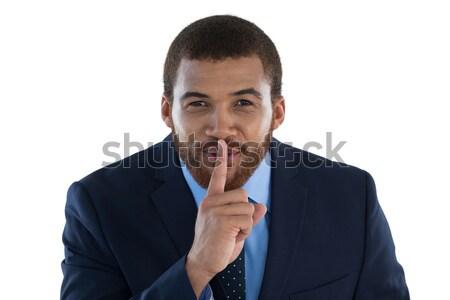 ビジネスマン 立って 指 唇 白 ビジネス ストックフォト © wavebreak_media