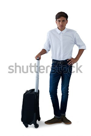 Male executive with luggage talking on mobile phone Stock photo © wavebreak_media