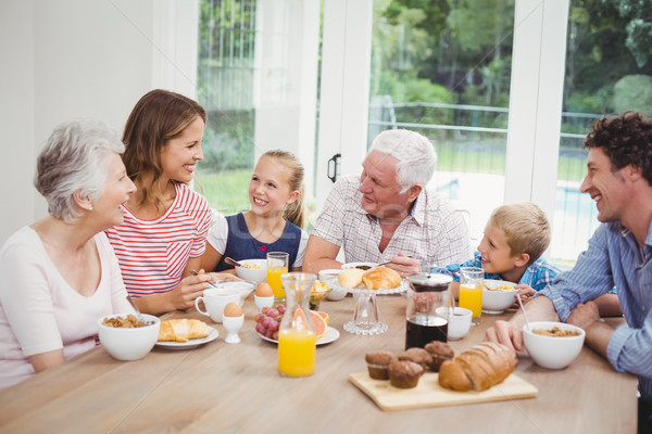 Happy multi-generation family having breakfast Stock photo © wavebreak_media