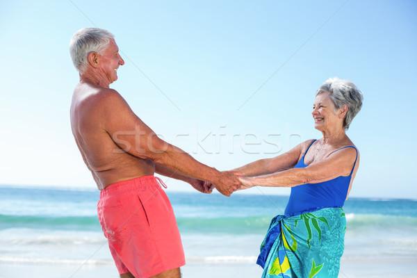 Cute mature couple holding hands on the beach Stock photo © wavebreak_media
