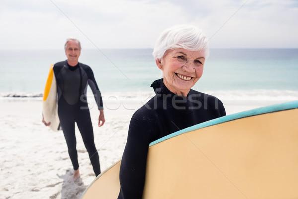 Casal de idosos prancha de surfe praia retrato Foto stock © wavebreak_media