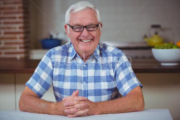 Portrait of smiling senior man with hands clasped  Stock photo © wavebreak_media