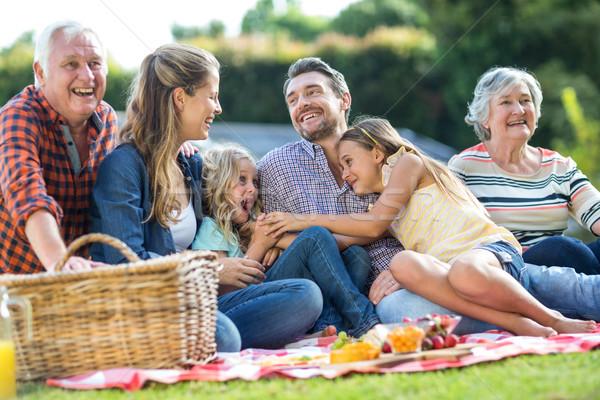 Boldog család ül pléd nevet nő Stock fotó © wavebreak_media