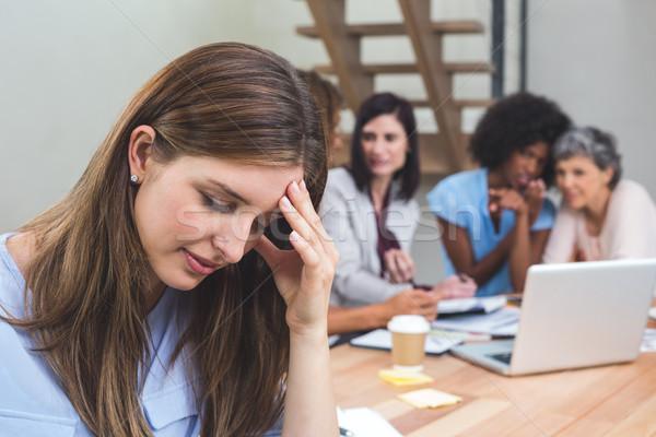 Tense businesswoman sitting in office Stock photo © wavebreak_media