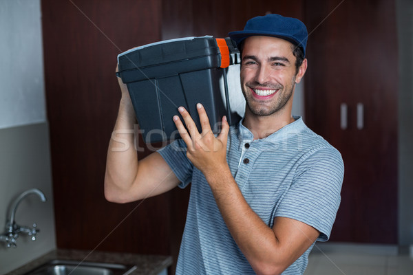 Portrait of smiling man carrying toolbox  Stock photo © wavebreak_media
