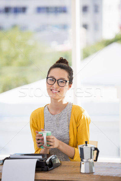 Hipster holding a cup of coffee Stock photo © wavebreak_media