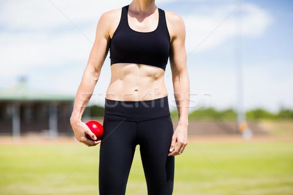 Középső rész női atléta tart lövés labda Stock fotó © wavebreak_media