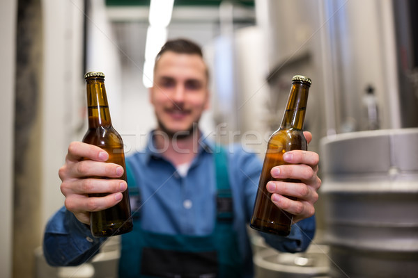 Brewer holding two beer bottle Stock photo © wavebreak_media