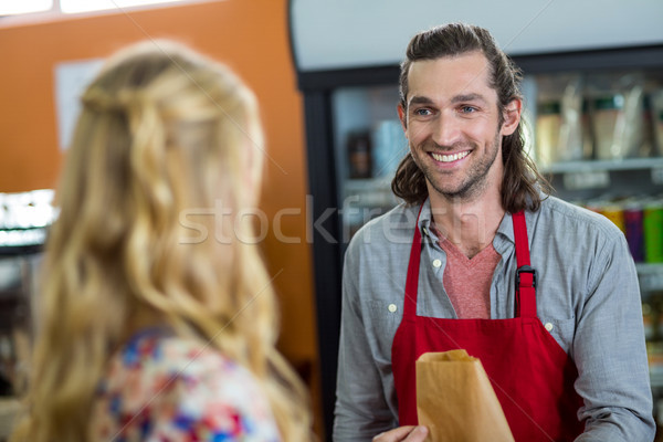 Male staff interacting with woman in supermarket Stock photo © wavebreak_media