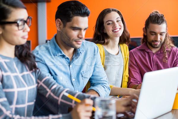 Uśmiechnięty graficzne laptop spotkanie biuro Zdjęcia stock © wavebreak_media