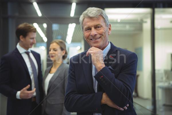 Happy businessman standing in the office Stock photo © wavebreak_media