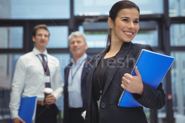 Boldog üzletasszony áll spirál könyv iroda Stock fotó © wavebreak_media