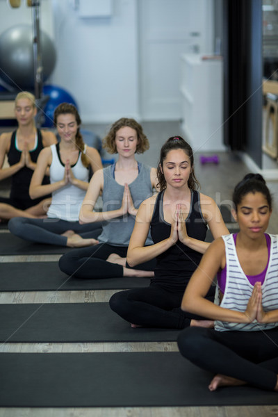 Group of women performing yoga Stock photo © wavebreak_media