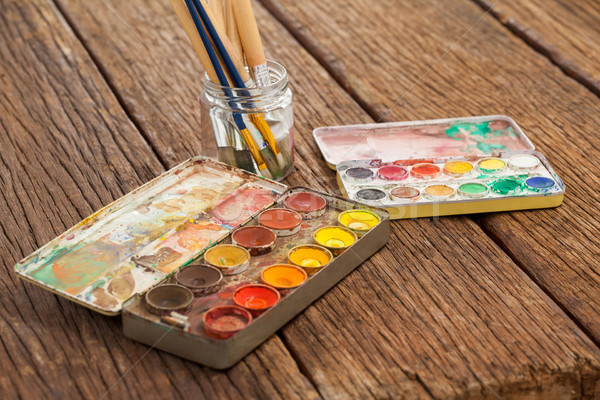 Paint brush in a jar filled with water and watercolors Stock photo © wavebreak_media