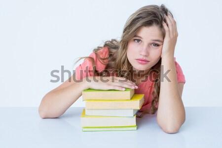 Tired hipster lying on table  against white tiling Stock photo © wavebreak_media