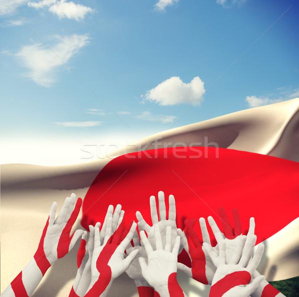Composite image of people raising hands in the air Stock photo © wavebreak_media
