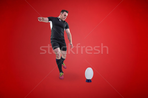 Composite image of rugby player kicking the ball Stock photo © wavebreak_media