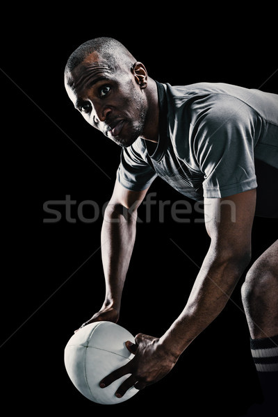 Composite image of rugby player looking away while holding ball Stock photo © wavebreak_media
