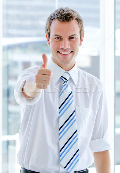 Portret charyzmatyczny biznesmen kciuk w górę biuro Zdjęcia stock © wavebreak_media