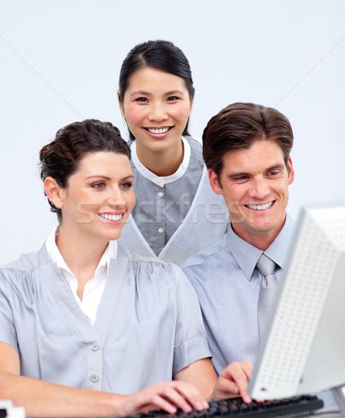 Ambiciózus üzletemberek dolgozik számítógép cég iroda Stock fotó © wavebreak_media