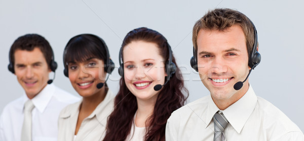 Smiling team working in a call center Stock photo © wavebreak_media