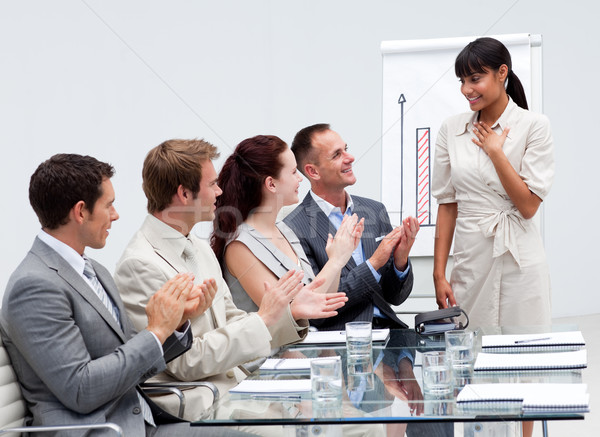 Business team applauding a colleague after giving a presentation Stock photo © wavebreak_media