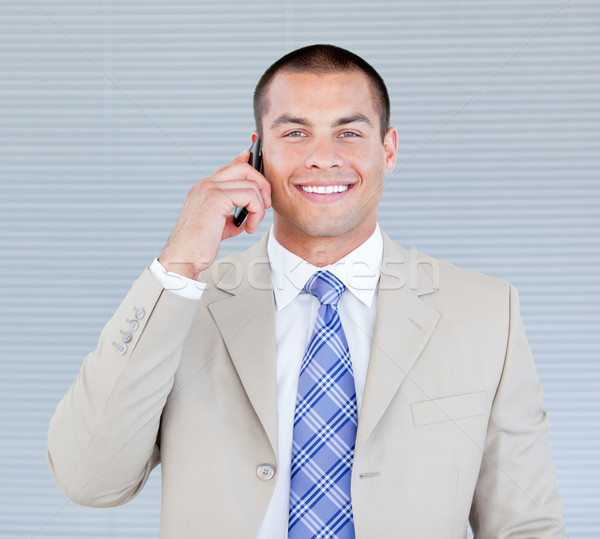 Self-assured businessman talking on phone Stock photo © wavebreak_media