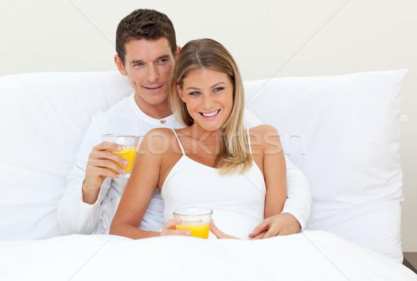 優しい カップル 飲料 オレンジジュース ベッド ホーム ストックフォト © wavebreak_media