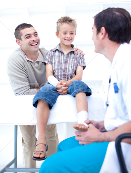 Doctor bandaging a patient's foot with his father Stock photo © wavebreak_media