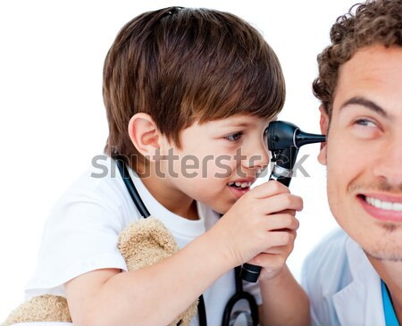 Cute little boy playing with his doctor  Stock photo © wavebreak_media