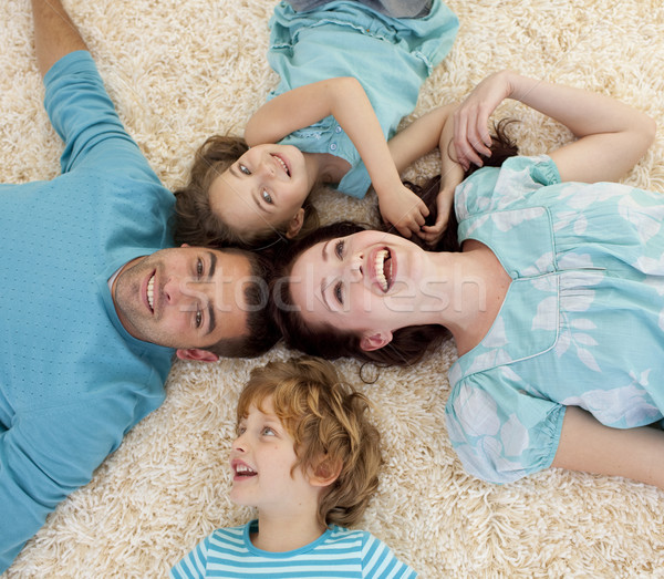 Smiling family on floor with heads together Stock photo © wavebreak_media