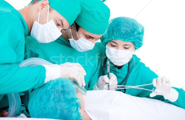 Professionnal medical team using surgery equipment on a patient Stock photo © wavebreak_media