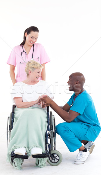 Afro-American doctor speaking to a patient in a wheel chair Stock photo © wavebreak_media